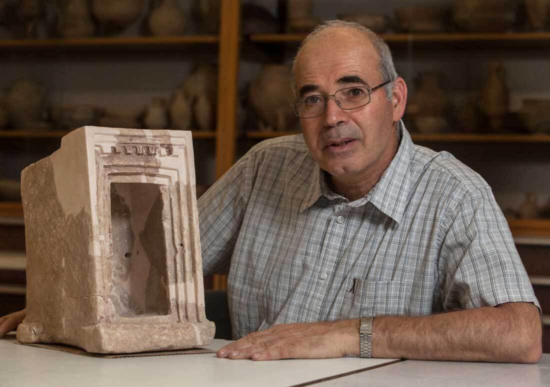 Yosef Garfinkel with a shrine model made of stone, found at Khirbet Qeiyafa