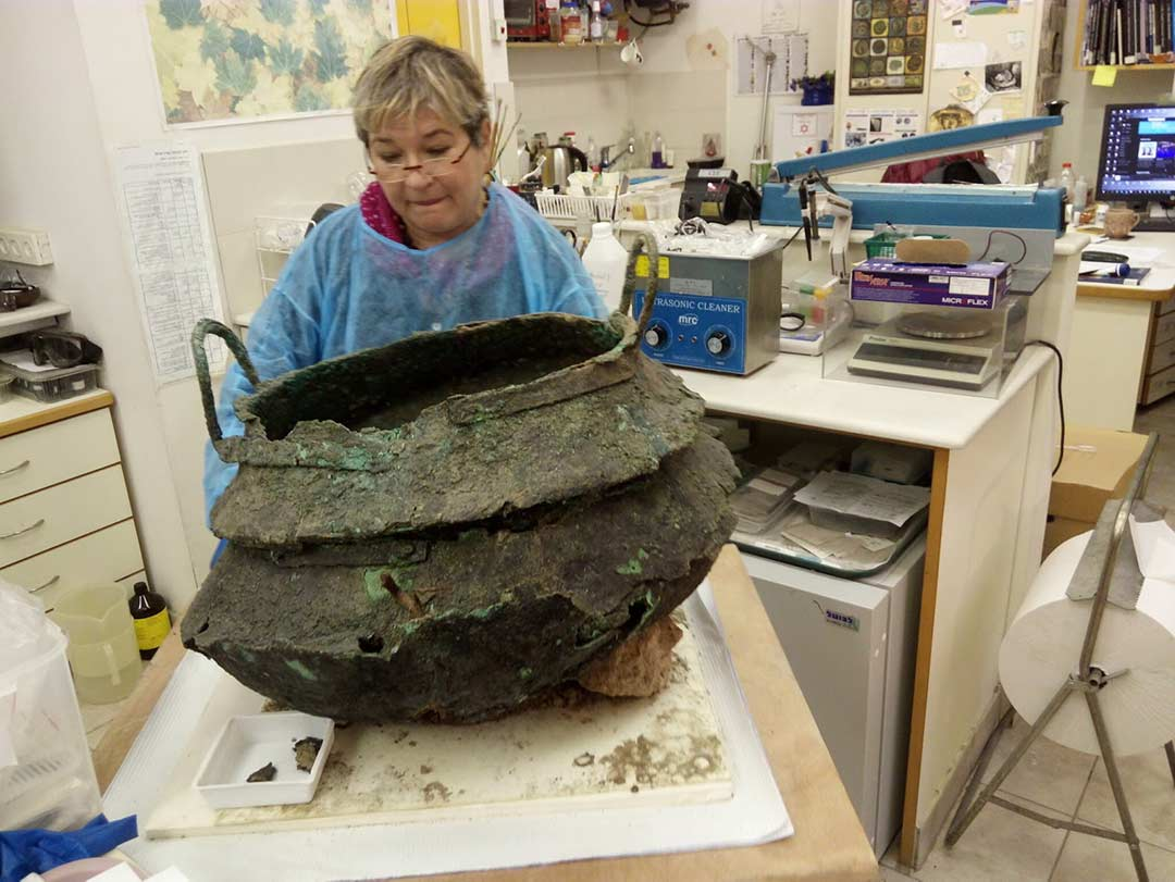 Restoring a bronze cauldron found during excavation of the temple at Tel Lachish