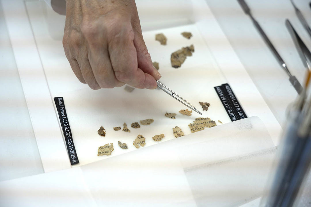 Scientists conserving scroll fragments from the Horror Cave