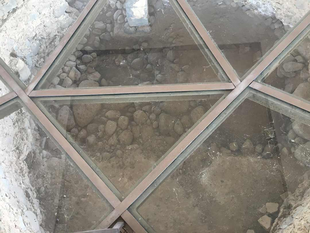 Looking through the glass floor where walls of Peter's house once stood