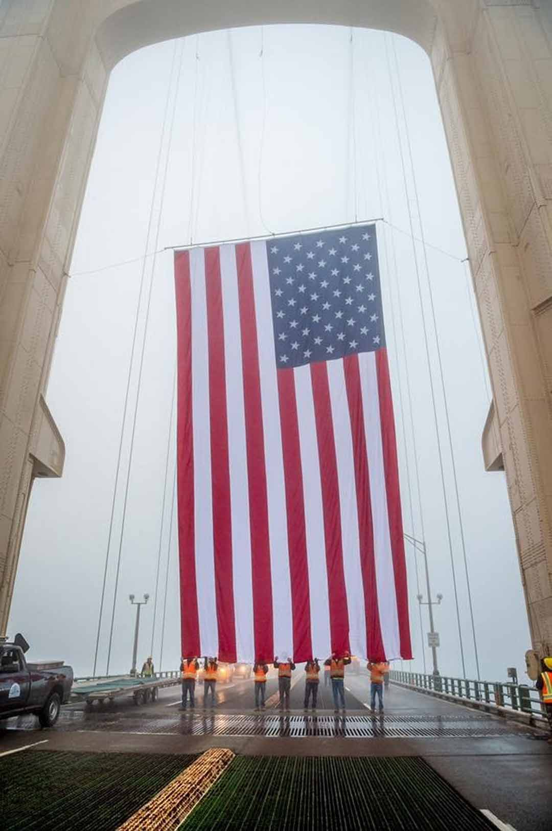 Giant American Flag suspended from the Mackinac Bridge in Michigan