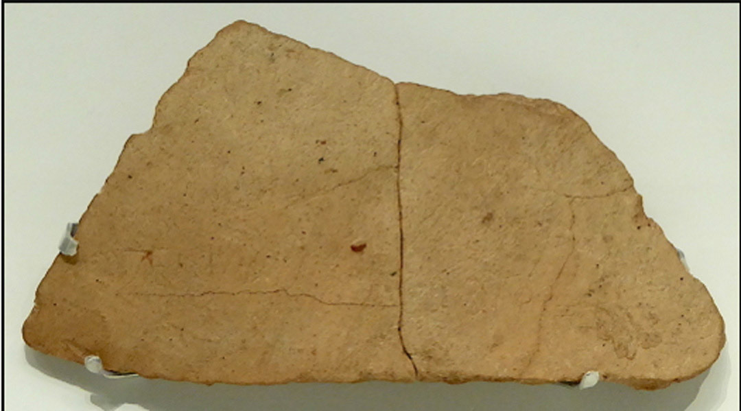 The 'Izbet Sarta abecedary on display in the Israel Museum)